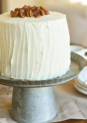 Cute cake stand made from.a metal pie plate and mini bucket.