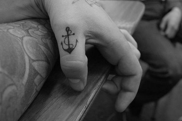 41 small black anchor on thumb http://hative.com/cool-anchor-tattoo-designs-and-meanings/