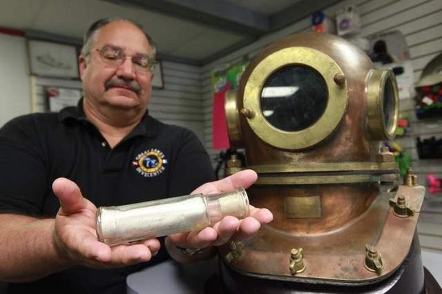 """Last June diver Dave Leander discovered a message in a bottle nearly a century old in the waters off Harsens Island near Detroit. The message read """"Having a good time at Tashmoo,"""" a reference to an amusement park that was a popular attraction on the island in the late 1800s and early 1900s. The message was signed by two Detroit girls, Selina Pramstaller and Tillie Esper, and was dated June 30, 1915. Historians are now trying to track down the descendants of the girls."""