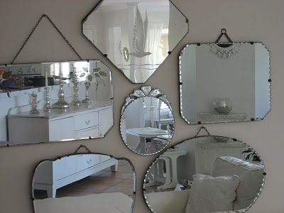 you can never go wrong with a cluster of old mirrors. they add warmth, reflect light, and make the room unique and larger,.....not necessarily in that order, but you know what I mean