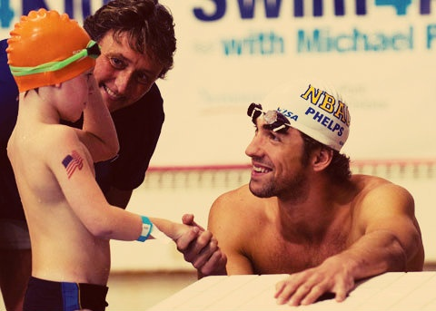 im dying..this is the cutest thing. An American world record holder and the future of swimming. Beautiful moment.