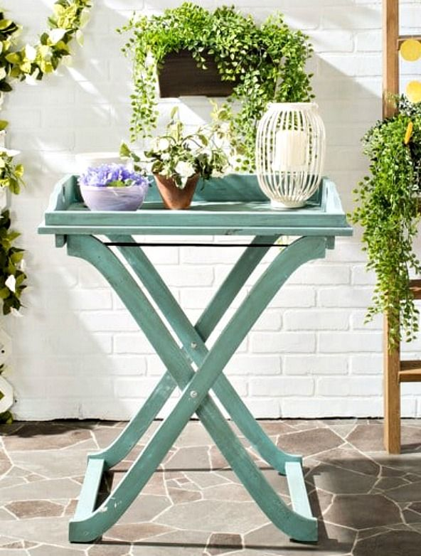 Inspired by British campaign furniture, the Covina outdoor tray table is designed for serving or snacking al fresco.