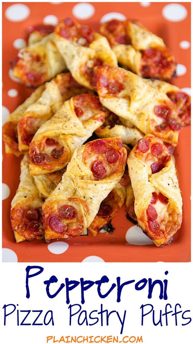 Pepperoni Pizza Pastry Puffs - two bite pizza! Only 5 ingredients and ready in 15 minutes! Perfect for parties and tailgating. We also like to eat these for a quick lunch. Whenever I take these to a party, there are never any left!! Can assemble and freez