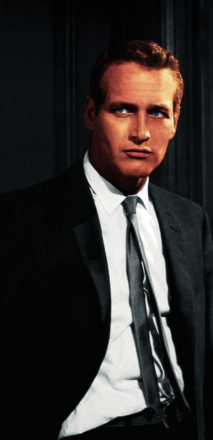 Paul Newman. What a handsome man..  who needs hair when you have those beautiful eyes