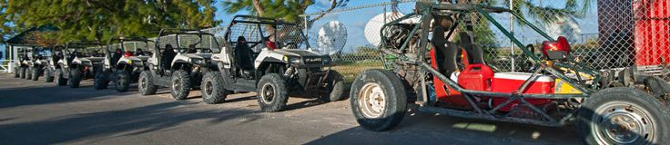 Dune buggies parked on Lighthouse Road, Grand Turk.