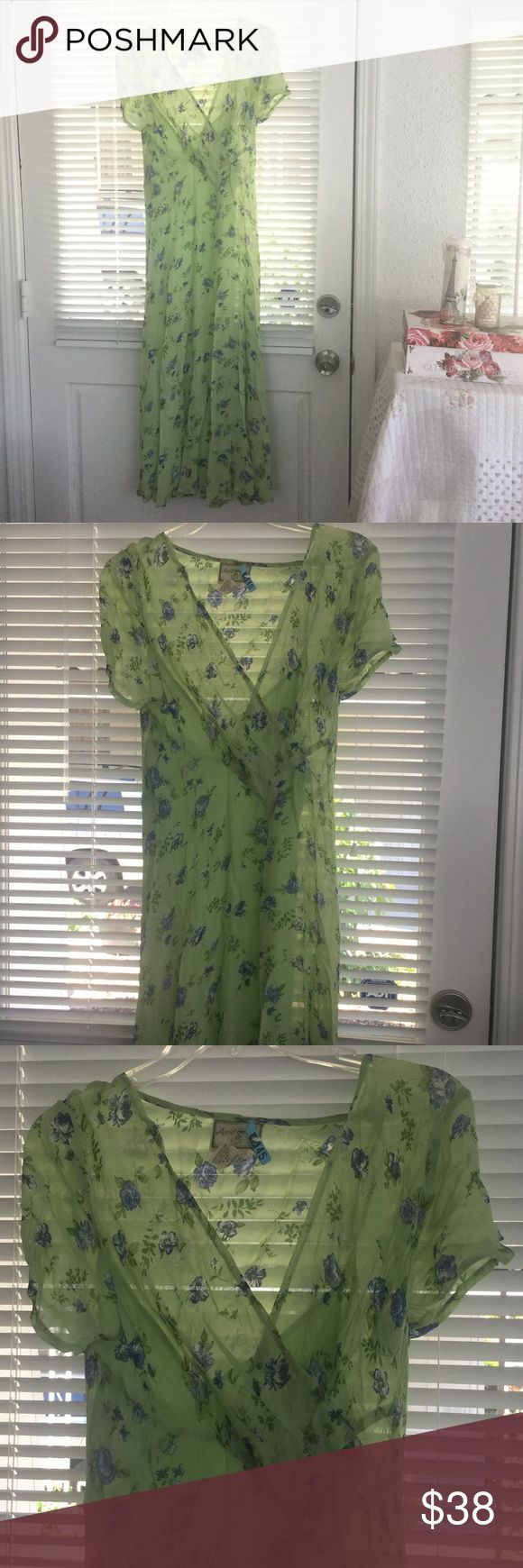 Lovely April Cornell mint green/lilac dress Sz S So perfect for Summer! Beautiful green with lilac flowers, has under slip. Very nice condition...has been dry-cleaned!  April Cornell Dresses Midi