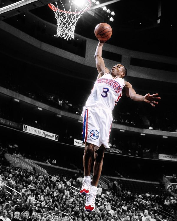 a young Allen Iverson approaching for a dunk during his rookie 1996-97 season for the Philadelphia 76ers.