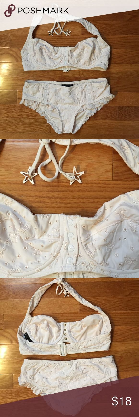 Bikini Cute cream bikini with skulls and ruffles.  Starfish tie has slight wear on the paint on the tips of the starfish arms. Overall this is in great condition as I only wore it once. Petite bottom and size L top. Swim Bikinis