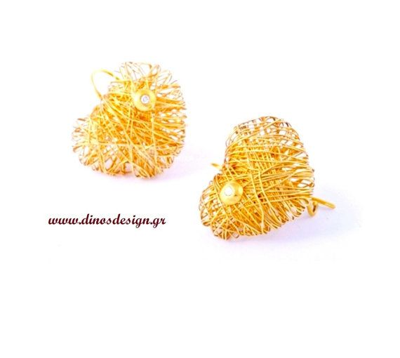 Gold earrings. High fashion. Elegant jewelry. by DinosKoukiaris
