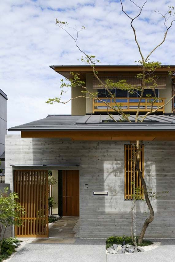 attractive japanese house design exterior with natural cement wall and wooden sliding door on gate in - Japanese Home Design