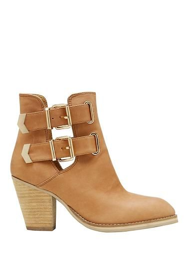 Leather cut out ankle boot, featuring double buckle . Leather upper / Synthetic lining / Man made sole. Heel height 8cm SEED HERITAGE