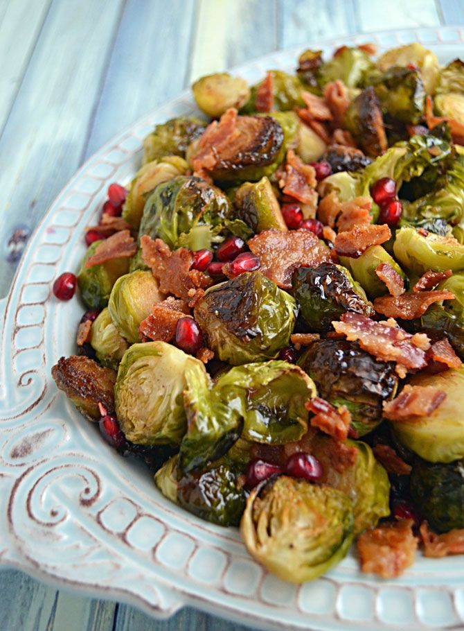 Roasted Honey Balsamic Brussels Sprouts with Bacon and Pomegranate Seeds.  Who knew brussels sprouts could be so delicious?   blog.hostthetoast.com