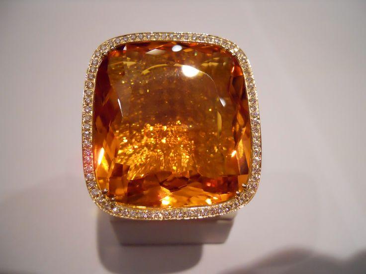 """""""Sunny"""" ring. An 88.00cts orange citrine on 18k yellow gold with diamonds all over, even beneath topaz. Unique."""