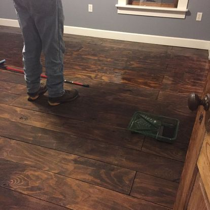 hardwood floors from plywood yes , flooring, hardwood floors, woodworking projects, Apply the poly with a flat type of mop head