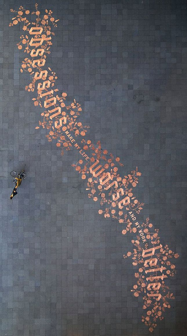 """Penny street art from Amsterdam: """"obsessions make my life worse and my work better"""". Enlarge this image to get it's proportion. Notice the bicycle. From Stefan Sagmeister's series of work """"Things I have learned in my life so far""""."""