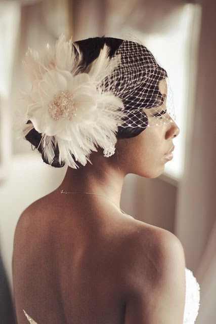 Her birdcage veil and fascinator are so beautiful!