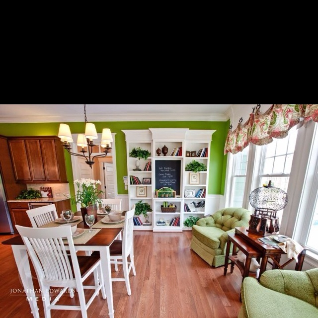 Love the seating area off kitchen ad white with green !!