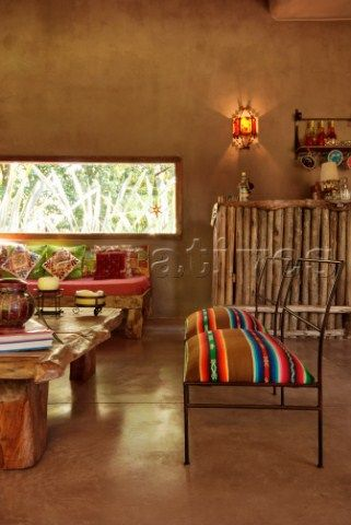 Love the idea of updating chair upholstery with Mexican blanket!