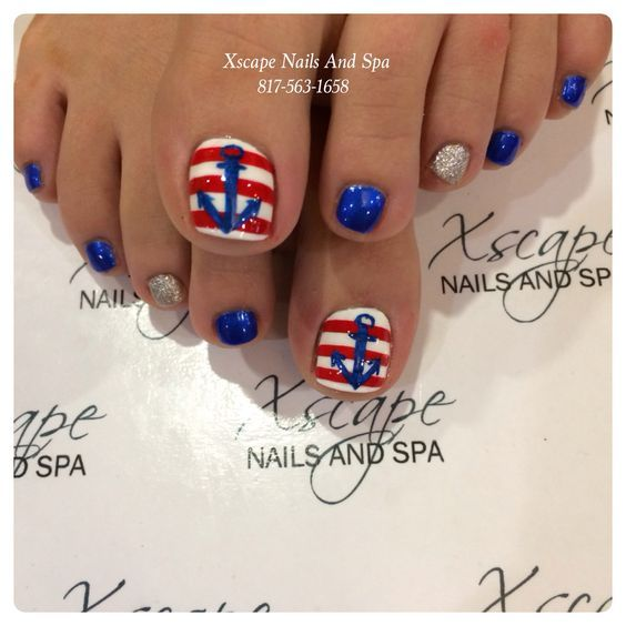 Pretty pedicure: Nautical theme: Red & White stripes with a Blue anchor on each of the big toe nails, then blue and silver on the small toe nails.