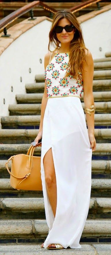Gorgeous white summer mixi with top beaded blouse and brown leather hand bag and golden shoes and gold braslate and black goggles the best way to show fashion style