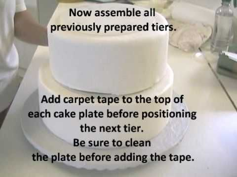 """http://www.CakeSuppliesPlus.com for cake photos and supplies in video.   """"Like"""" us on facebook at http://www.facebook.com/CakeSuppliesPlus  Cake Decorating: Video shows how to stack a wedding cake using pillars. Stacking the cake with pillars  creates a very sturdy method of support."""