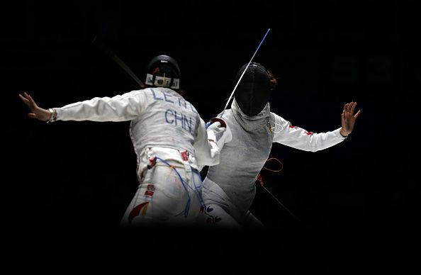 Le Huilin of China and Oh Ha-Na of South Korea compete in the Women's Foil Team Final during the 2014 Asian Games at Goyang Gymnasium on September 24, 2014 in Incheon, South Korea. (Photo by Chung Sung-Jun/Getty Images)