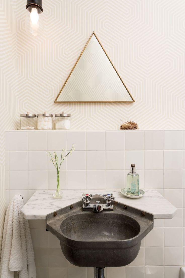 Interesting Triangle Bathroom Mirror And Dark Sink.