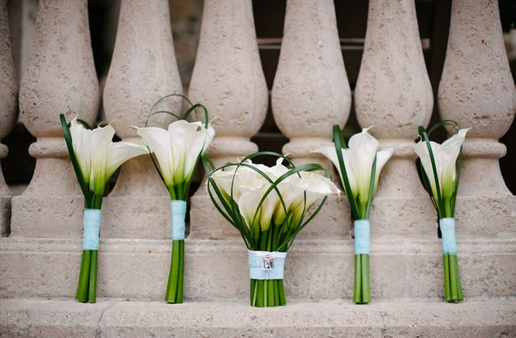 white calla lily bouquets- maybe a locket with my boys' pictures in it