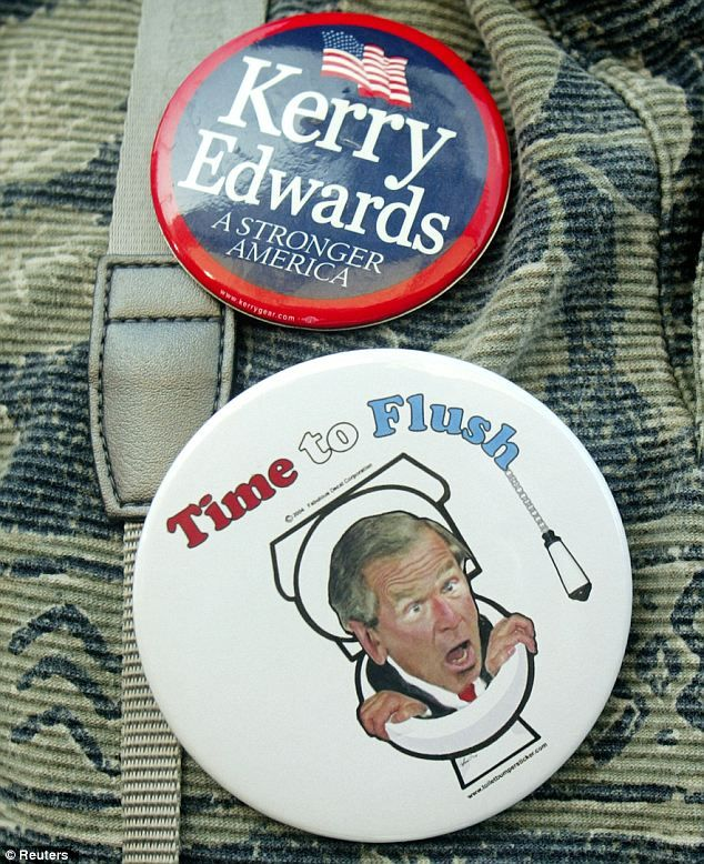 Fight: Supporter of U.S. Democratic presidential nominee John Kerry wears buttons at a rally in West Palm Beach, Florida, October 29, 2004