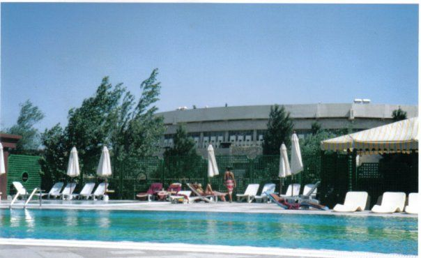 Pool at the Grand Europe. In the background is the Formerly the V.I. Lenin palace of culture, then the Republic Palace, like many other places it was renamed after Heydar Aliyev folllowing his death. This concrete and glass building faces a wide square with gardens and fountains and the red tower of the National Bank of Azerbaijan. The Republic palace can seat an audience of 2000. Its construction dates from the 1970s, with a design by architects V.Shulgin and E. Melkhisedekov.