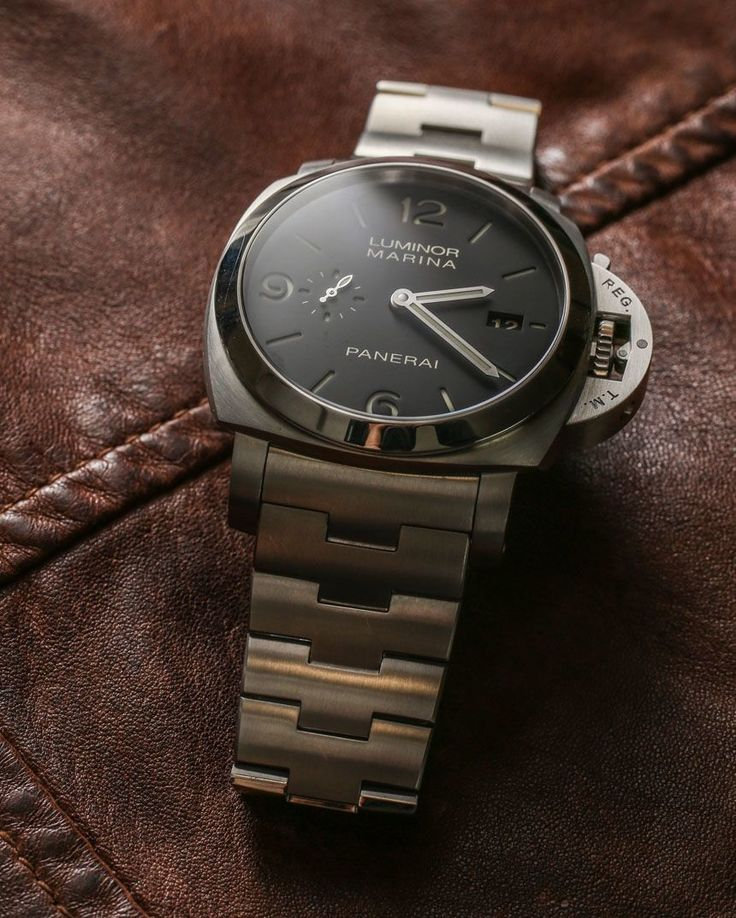 """Officine Panerai Luminor Marina 1950 3 Days Automatic PAM328 On Bracelet Watch Review - by Ariel Adams - see the full photo gallery, video, & read more - on aBlogtoWatch.com """"For many people, the quintessential modern Panerai is the Luminor 1950. This 44mm-wide case is what most people picture when they think of Panerai with is distinctive locking crown-guard system and chunky style. While Panerai does offer a (small) degree of variety among the various dials it pairs with the Luminor…"""