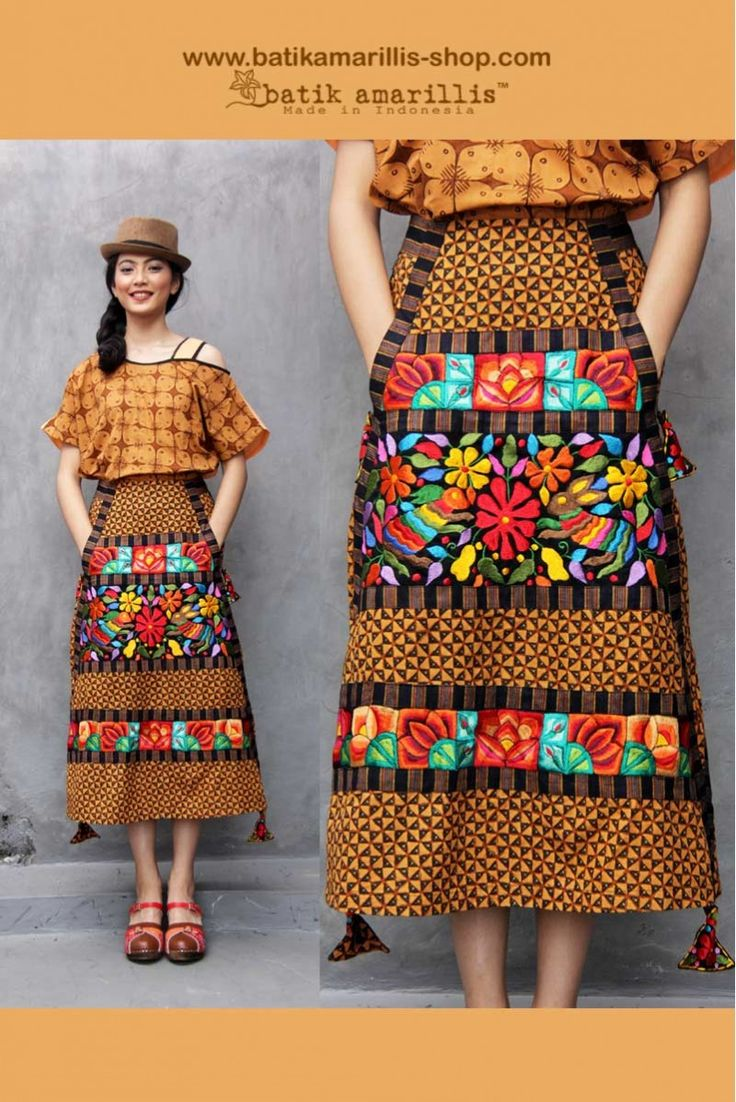 Batik Amarillis's Arcana Pyramida skirt , such a unique design with its kangaroo pocket, more patchworking with heavy play of bold pipings-more Arcana Tassels -this is all about our love &  passion towards Indonesia's traditional textiles such as batik ,ikat,lurik ,tenun which we combined with some other cultures of the world- this is the cocktail of Indonesia's Traditional textile batik Kawung sragen ,Lurik Surjan Jogjakarta with Mexican Embroidery style /inspired