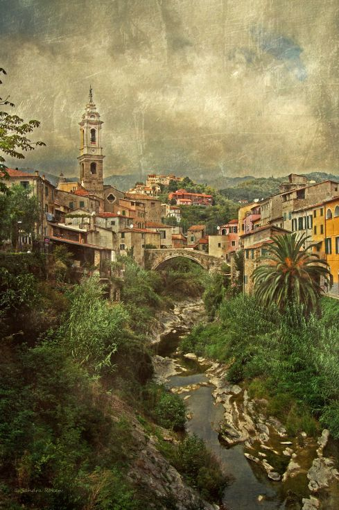 ARTFINDER: Dolcedo by Sandra Roeken - The beautiful village Dolcedo in Liguria / Italy  The photo was taken by me, first digitally optimized, then layered with textures and intensively worked o...