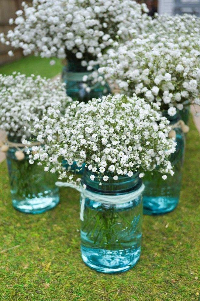 blue mason jars with flowers