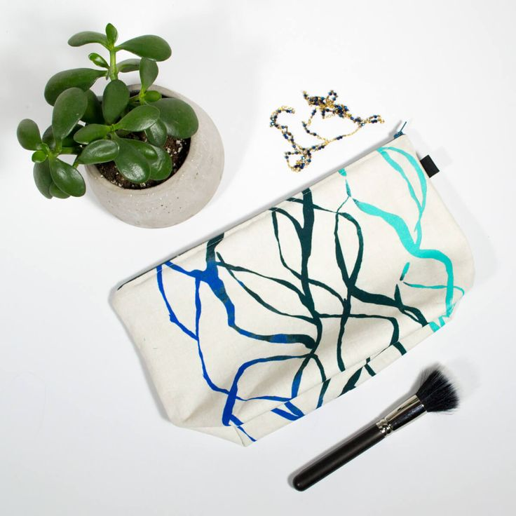 """Travel kit - Lianes  Makeup bag with waterproof interior, perfect for all your cosmetics, flat iron and all your toiletries during your small or big trip  Print exterior fabric (100% cotton) Waterproof nylon interior  Dimension: 12-1/2 """" x 7-1/2""""h Base 4"""" large Zipper 12"""""""