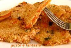 Le cotolette di zucca al forno sono un ottimo piatto vegetariano, ricco di sapore e proprietà nutritive.