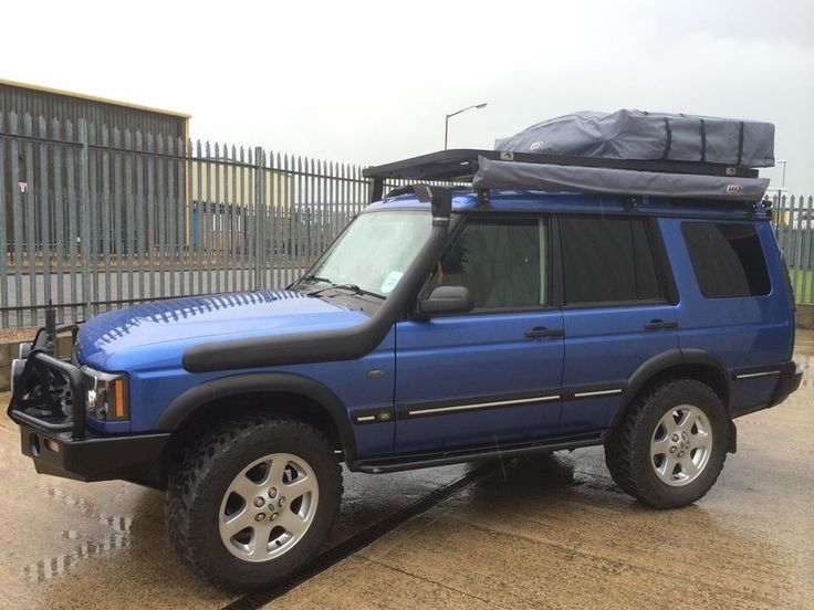 """2004 Land Rover Discovery ES Premium with: ARB Bullbar 9000lb Winch with synthetic rope HID Lightforce 170s Mantec steering guard QT diff guards 2"""" HD Lift, with air on the rear 275/65/18 Cooper STTs 30mm wheel spacers EBC drilled and grooved discs Safari 'style' snorkel ALIVE tuning Stage 2 Package ARB Compressor Ashcroft rear air locker Tree sliders Cb radio Flatdog Rax ARB RTT + Awning ARB 35L Fridge + Slide Window Guards + Mantec shelf"""
