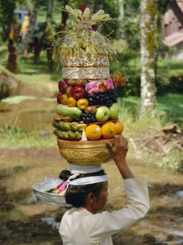 Woman Carrying Food Offerings on Her Head, Island of Bali