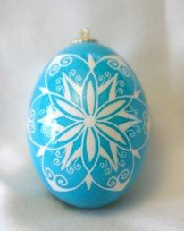 """Click through for an entire gallery of beautiful """"Sky Blue Snowflake Pysanky"""" from the """"Nontraditional Pysanky"""" site where she's explaining how to have decorated eggs for all sorts of festivities all year round."""