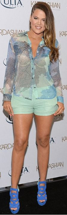 Khloe Kardashian: Shorts -Giuseppe Zanotti  Shirt – Equipment  Shorts – La Marque