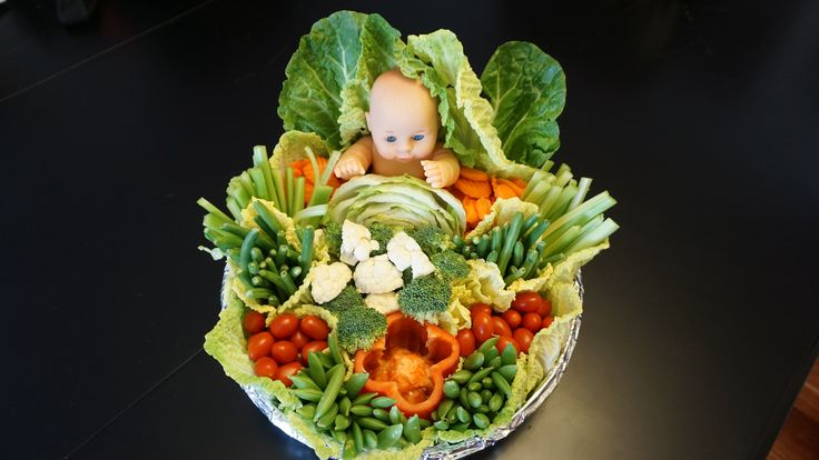 A unique vegetable tray for a baby shower.