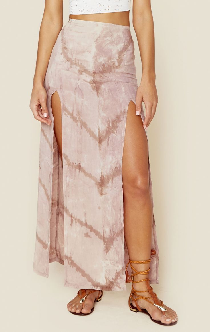 Show a little leg in the 2 Slit Maxi Skirt by Blue Life . Features an elastic waistband at back and two super high front slits in an all over pink tie dye print.   Made in USADry Clean Only100% RayonF