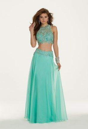 The two-piece look is a super hot trend for this prom's season! Showcase your inner fashionista at the most important event of your high school career in this sexy number! The cropped bodice is comprised of Venetian lace and sweet illusions that complement the matching skirt waistband. Chiffon sweeps beautifully as you dance the night away with a full stunning skirt. This statement-making prom dress will not go unnoticed just complement it with high heel sandals, crystal and rhinestone…