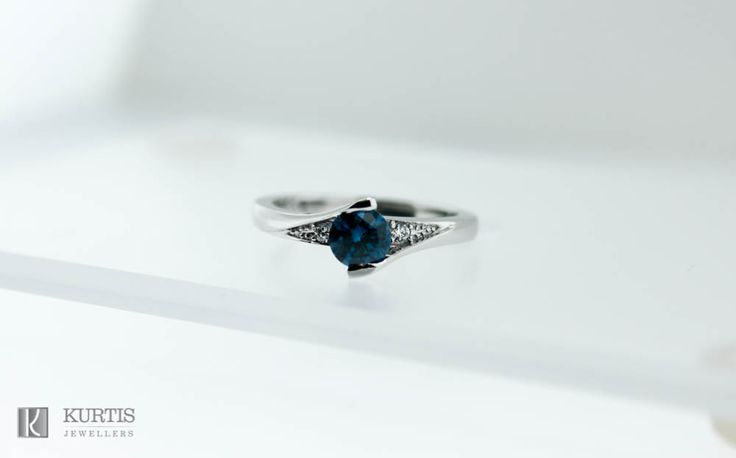 Round blue diamond in white gold setting. Engagement ring. www.kurtisjewellers.com