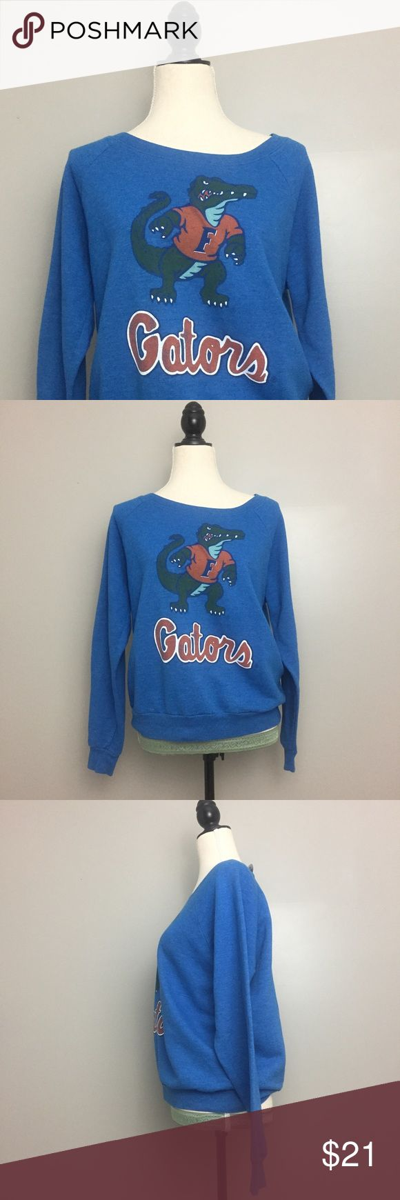 Recycled Karma Blue Florida Gator  Logo Sweatshirt Recycled Karma. Size Medium. Blue. Florida Gaters logo. Vintage style. Collegiate Sweatshirt. Pull over. Opaque.  Pull on closure. See photographs for measurements, shown on size Medium dress form. Excellent Preowned Condition. Recycled Karma Tops Sweatshirts & Hoodies
