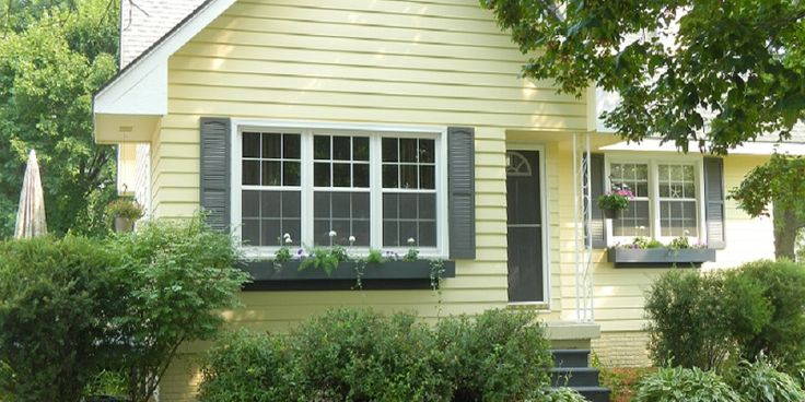 Ranch Home with Dark Green Shutter and White Trim