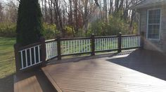 Deck Stained in Sikkens Dark Chesnut, Balusters Painted in Classic White.
