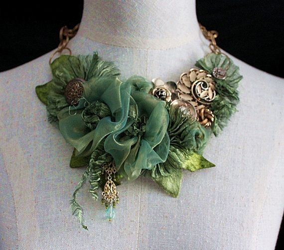 Green necklace made with fabric, chain, and beading.