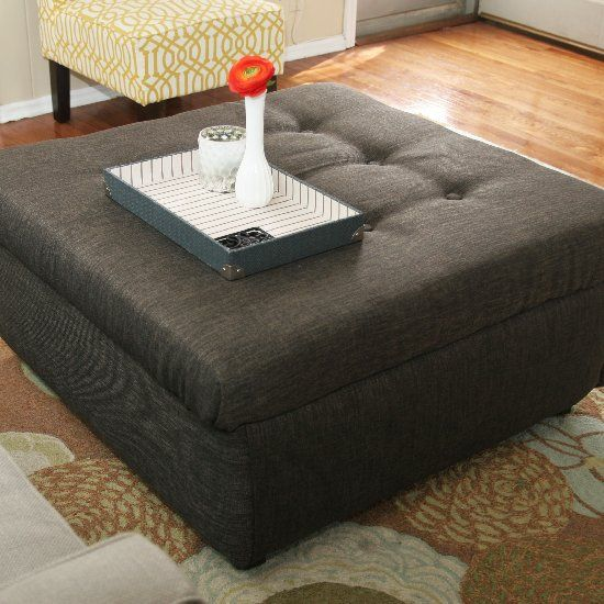 Turn an ugly coffee table into a tufted ottoman with this easy tutorial!