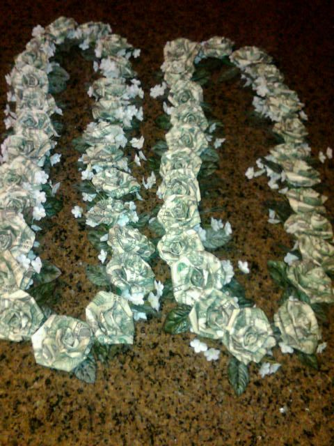 Dollar Origami - Rose made of 4 one dollar bills. For Graduations or Luau's money lei